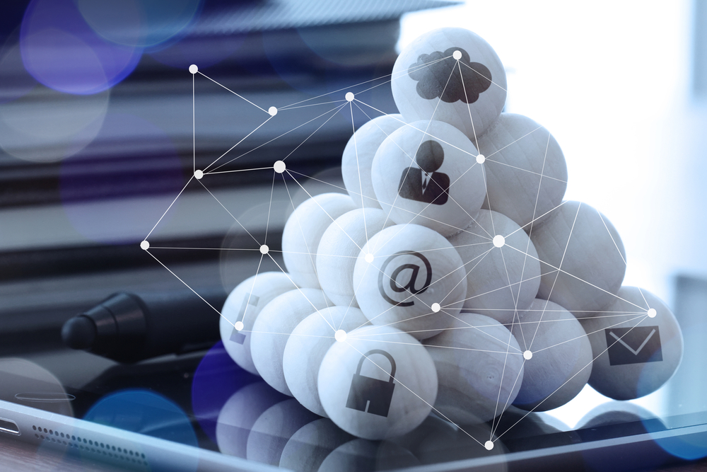 wooden balls with technology icons and diagram media on computer as cloud network concept